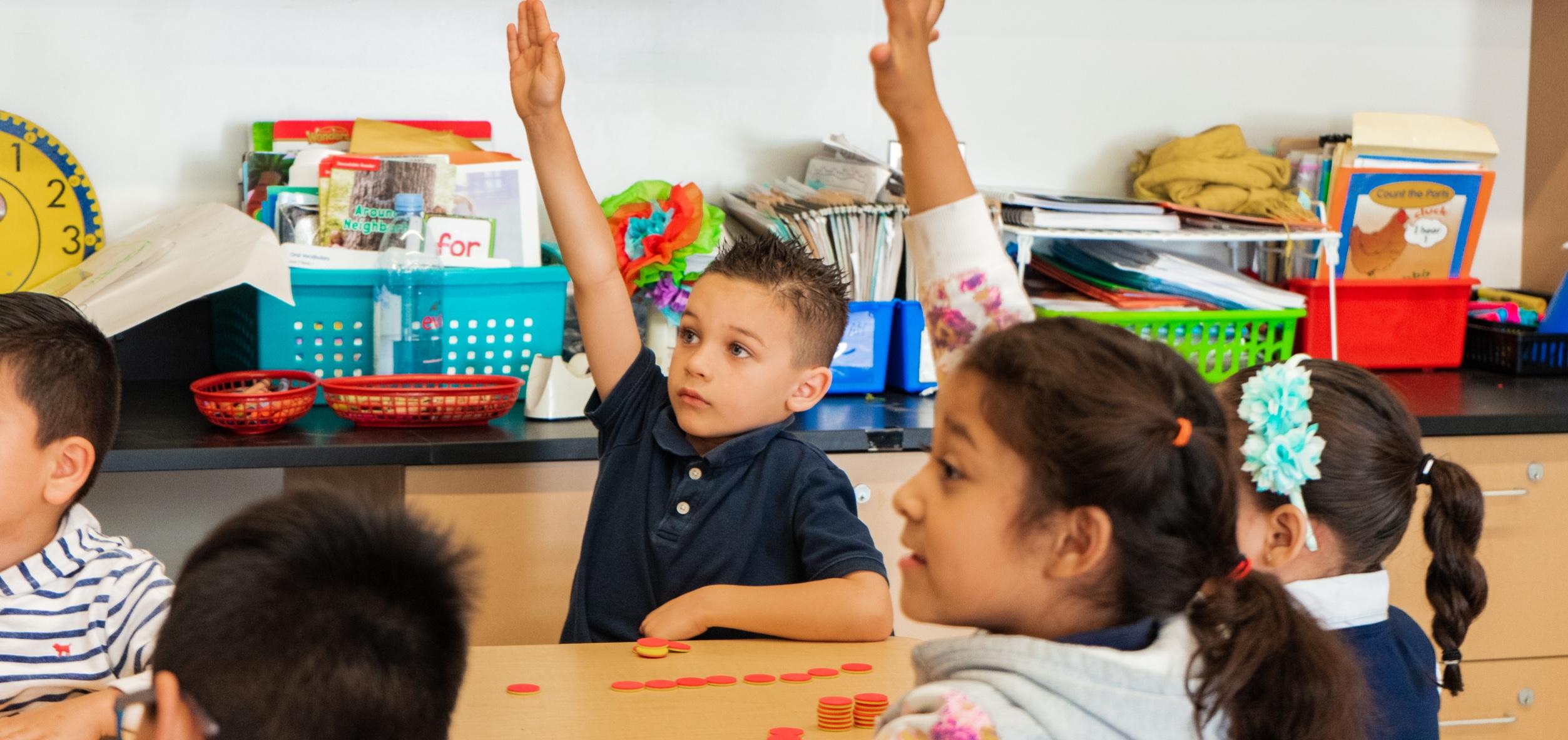 Children raising hand