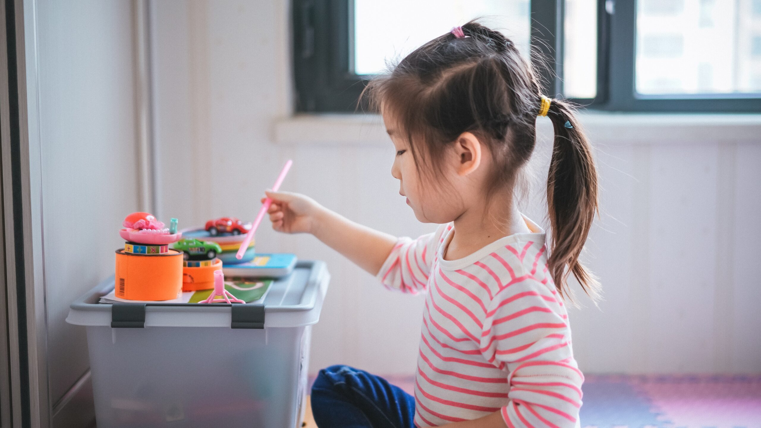 Young preschool student playing with paint